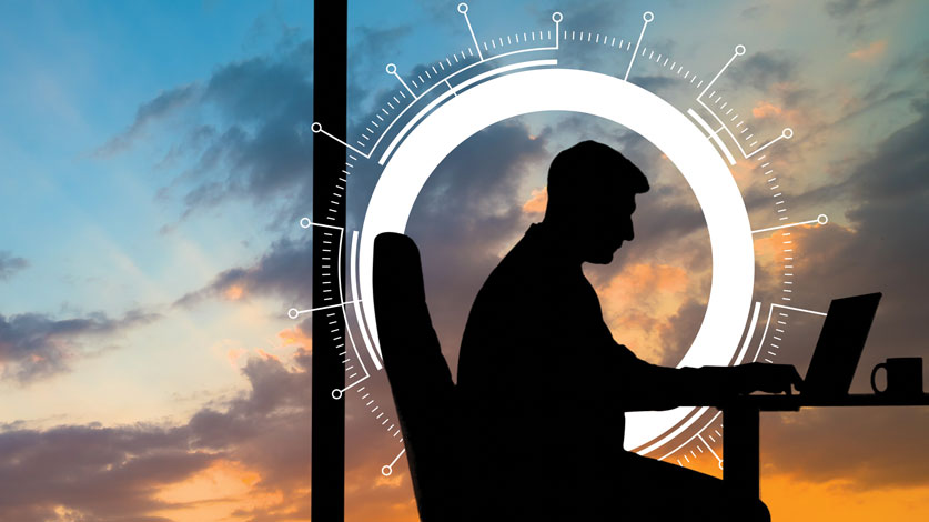 man in office at sunset